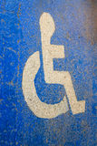 Way for disabled. Wheelchair sign on blue floor Stock Photo