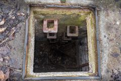 Way down into a Sewage Manhole.  Royalty Free Stock Images