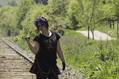 That way. Goth girl on the tracks trying to hitch a ride Stock Images