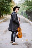 In way with guitar. In way with acoustic guitar in the park royalty free stock photography