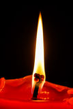 On way home on fire - flame ahead. Tall flame and the red candle Royalty Free Stock Photo