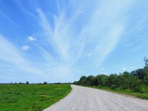 Road , fields and beautiful cloudy sky, Lithuania Royalty Free Stock Photography