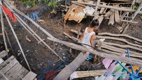 Coron, Philippines - January 5, 2018: The way of life of children and families in the Filipino slums. Poverty. Children