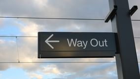 Way Out/Exit sign under a sunny sky stock photo