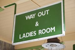 Way Out and Ladies Toilet Sign Stock Photography