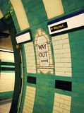Way Out London Tube. Way Out direction signs on London Tube station, showing old and new designs stock photography