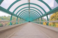 The way out of modern metal structure bridge. A way out of modern metal structure bridge royalty free stock image
