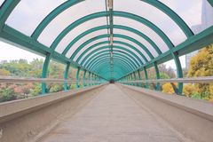The way out of modern metal structure bridge. A way out of modern metal structure bridge stock photos