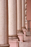 Way out with row of pink marble columns royalty free stock image