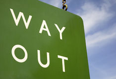 Way Out Sign. Green way out station sign on blue sky background Stock Photos