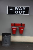 Way out sign and fire buckets at an old railway station Stock Photo