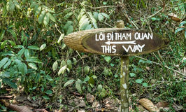 Way Out - Sign in the Forest. Detail of a sign in a vietnamese forest near Cu Chi Tunnels Royalty Free Stock Photo