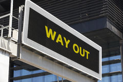 Way out signpost in the city with building facade background Stock Image