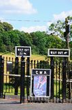 Way out signs and war poster, Highley. Royalty Free Stock Photos