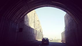 On the way. Photo taken from inside the tunnel. As the tunnel ends.... the darkens fades Royalty Free Stock Photo