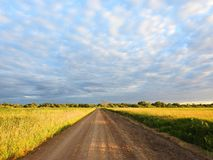 Road , fields and beautiful cloudy sky, Lithuania Royalty Free Stock Photos