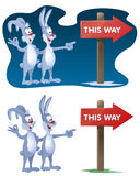 This way. Rabbits found the signpost. Cartoon styled vector illustration. Elements is grouped for easy edit. No transparent objects.  On dark  background and Royalty Free Stock Image