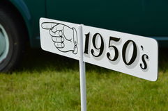 This way for the 1950 sign. Sign pointing to the 1950 stock photography