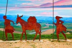 The way of Saint James Alto del Perdon Navarra. The way of Saint James Alto del Perdon top with steel sculpture of pilgrims at Navarra Stock Photo