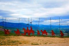 The way of Saint James Alto del Perdon Navarra. The way of Saint James Alto del Perdon top with steel sculpture of pilgrims at Navarra Stock Images