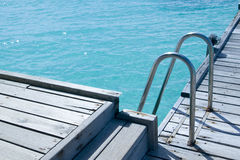 A way into the Sea. A ladder way into the open sea in maldives Stock Images