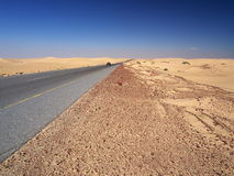 On the way from Shannah to Al Ashkharah. Sand desert on the way from Shannah to Al Ashkharah, Oman Stock Photos