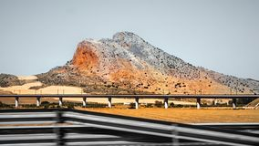 On the way somewhere in Andalusia. Railway bridge with rocky hills in Andalusia, Spain Stock Photography