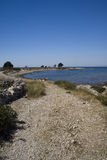 Way to the beach. Scenic beach in Novalja on island Pag, Croatia Royalty Free Stock Image
