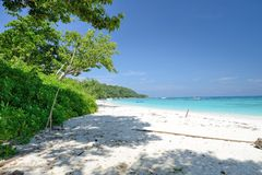 The way to the beach and sea between tree at Ko Ta chai Island in Thailand. The way to the beach and sea at Ko Ta chai Island in Thailand Stock Photos