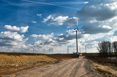 Way to build windmills. Under white clouds and blue sky Stock Images