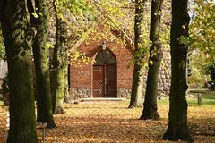 Way to the church. In autumn royalty free stock photos