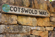This way to the Cotswolds. A view of a signpost pointing the way to get to the Cotswolds Royalty Free Stock Image