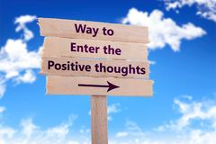 Way to enter the positive thoughts. Wooden sign with blue sky background Stock Image