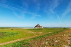 Way to the famous Mont Saint Michel abbey. Landscape photo during sunrise. Normandy, France. Way to the famous Mont Saint Michel abbey. It is one of the most Stock Photography