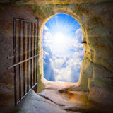 Way to freedom. Way to freedom or to heaven. Opened door from prison or grave. Hope metaphor Stock Photography