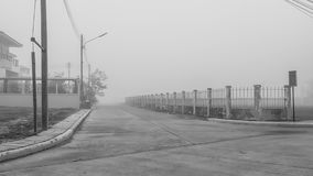 The way to get home is needed to pass the cloud of fog. In winter, the fog is covering everything. It is hard to go and see the road, should stay home Royalty Free Stock Photos