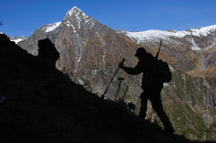 Way to go. Silhouette of hunter in  South Westland's Southern Alps, New Zealand Royalty Free Stock Photos