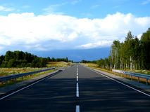 Way to heavens. Straight road to forward skyline Stock Images