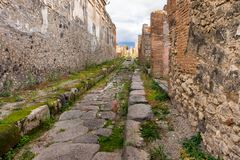 Way to the horizon in Ruins of ancient city of Pompeii royalty free stock photos