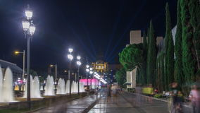 Way to Magic Fountain light show timelapse hyperlapse at night next to National museum in Barcelona, Spain. 1000 years. Of art. Lights and fountains are turning stock video footage