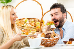 The Way To A Man's Heart Is Through His Stomach Stock Photo