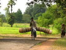 On the way to the market. Local Indian man riding a bicycle, carrying stuff to the market Stock Photography