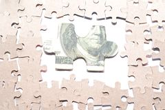 The way to money. The puzzle with the image dollar bills Stock Images