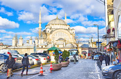 The way to the mosque. ISTANBUL, TURKEY - JANUARY 13, 2015: The busy street with many souvenir stalls and large parking goes to the entrance to the Nuruosmaniye Royalty Free Stock Image