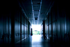 Way to other dimension. Dark corridor in tungsten light royalty free stock photography