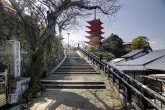 Way to pagoda at the Miyajima island, Japan. The stairs on the way leading to the pagoda on the Miyajima (Itsukushima) Island near the shinto shrine stock photo