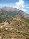 The way to the ruin. A view from Corse. You can see the path that leads you to a ruin on top of a hill in the distance Royalty Free Stock Photography