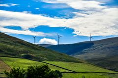 On the way to Scotland somewhere at the windmills stop. On the way to Scotland somewhere at the stop fantastic looking windmills among the mountains with stock image
