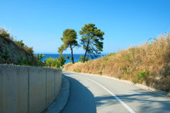Way to the sea. Road to the Aegean Sea. Greece, Kassandra, Halkidiki, Haniotis stock image