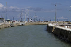 The way to the sea. The entrance to the harbor from the sea Royalty Free Stock Image